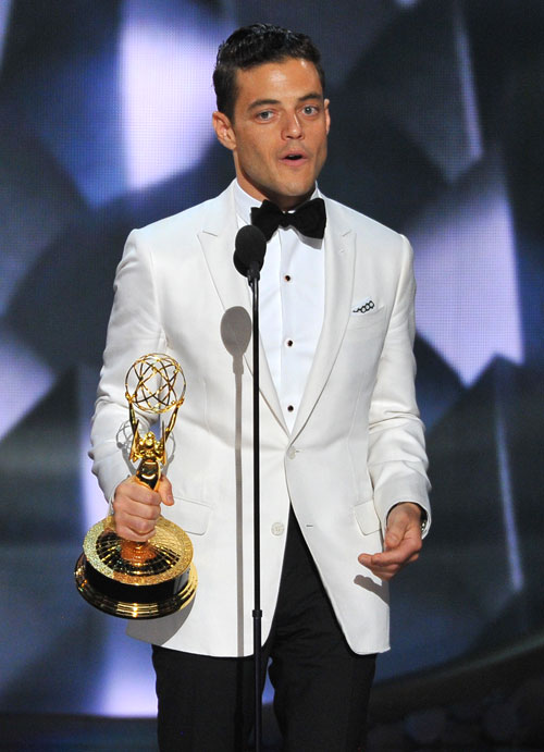 "<div class='meta'><div class='origin-logo' data-origin='AP'></div><span class='caption-text' data-credit='Photo by Vince Bucci/Invision for the Television Academy/AP Images'>Rami Malek accepts the award for outstanding lead actor in a drama series for ""Mr. Robot"" at the 68th Primetime Emmy Awards on Sunday, Sept. 18, 2016.</span></div>"