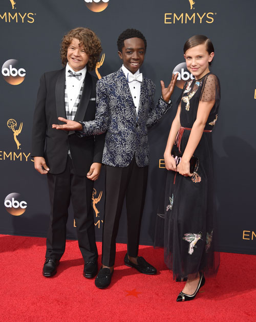 <div class='meta'><div class='origin-logo' data-origin='AP'></div><span class='caption-text' data-credit='Photo by Phil McCarten/Invision for the Television Academy/AP Images'>Gaten Matarazzo, left, Caleb McLaughlin, and Millie Bobby Brown arrive at the 68th Primetime Emmy Awards on Sunday, Sept. 18, 2016, at the Microsoft Theater in Los Angeles.</span></div>