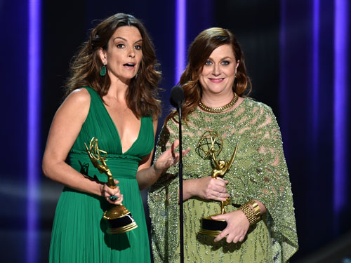 <div class='meta'><div class='origin-logo' data-origin='AP'></div><span class='caption-text' data-credit='Photo by Vince Bucci/Invision for the Television Academy/AP Images'>Tina Fey, left, and Amy Poehler, holding their awards for best guest actress in a comedy series, present the award for outstanding lead actor in a limited series or a movie.</span></div>