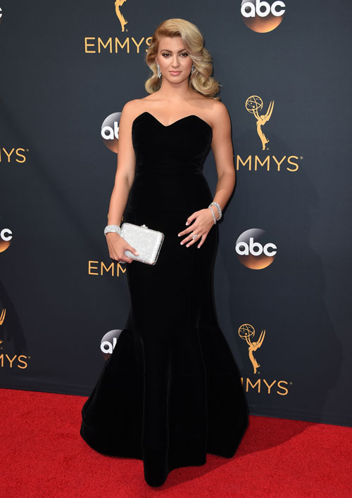 <div class='meta'><div class='origin-logo' data-origin='AP'></div><span class='caption-text' data-credit='Photo by Jordan Strauss/Invision/AP'>Tori Kelly arrives at the 68th Primetime Emmy Awards on Sunday, Sept. 18, 2016, at the Microsoft Theater in Los Angeles.</span></div>