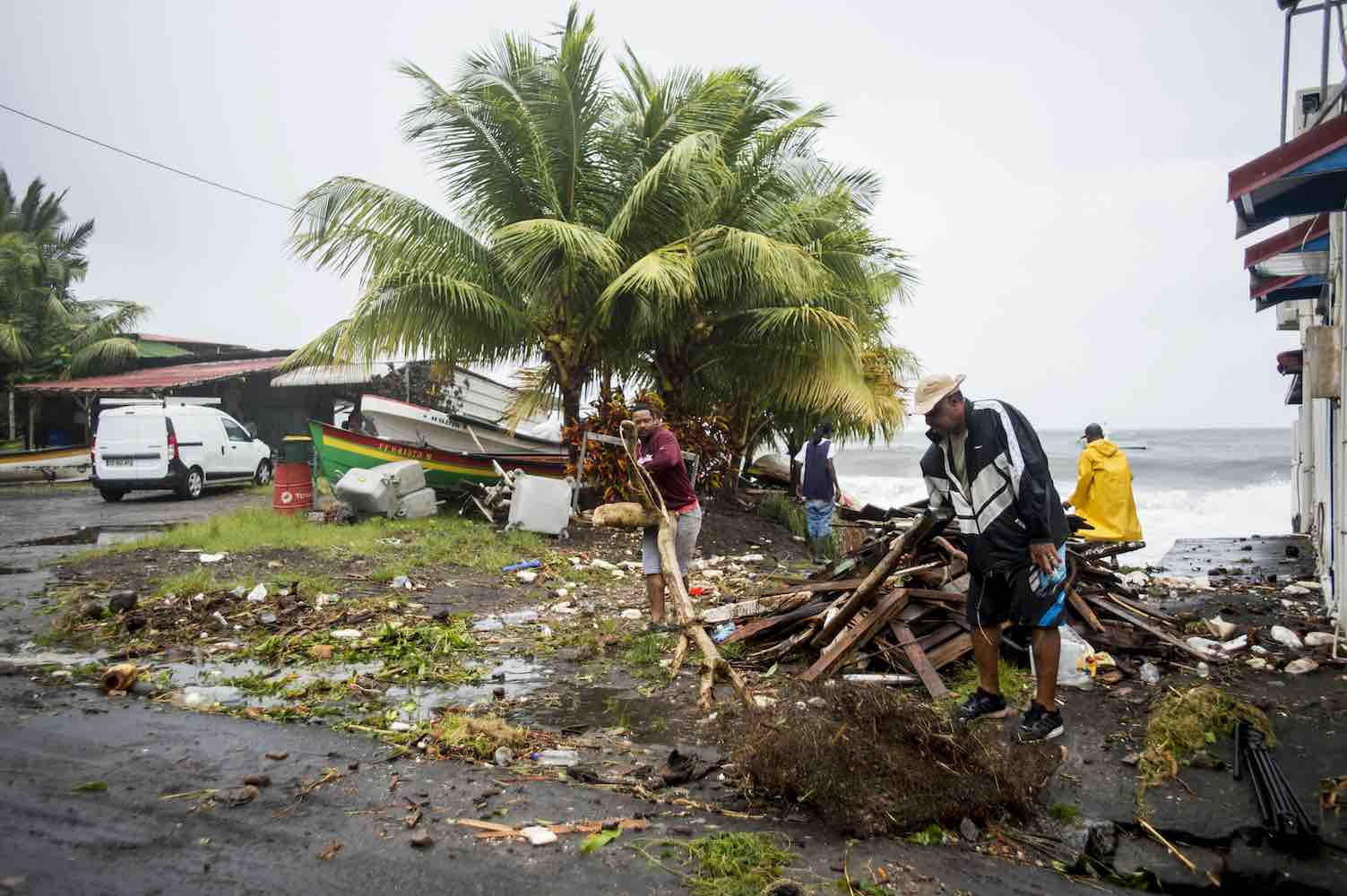 "<div class=""meta image-caption""><div class=""origin-logo origin-image wtvd""><span>wtvd</span></div><span class=""caption-text"">People clear debris in Saint-Pierre, on the French Caribbean island of Martinique, after it was hit by Hurricane Maria, on September 19, 2017. (LIONEL CHAMOISEAU/AFP/Getty)</span></div>"