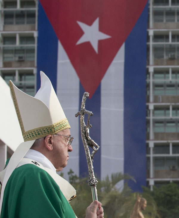 "<div class=""meta image-caption""><div class=""origin-logo origin-image none""><span>none</span></div><span class=""caption-text"">Pope Francis holds his pastoral staff after arriving for Mass at Revolution Plaza in Havana, Cuba, Sunday, Sept. 20, 2015, where a Cuban flag decorates a nearby building. (AP Photo/Alessandra Tarantino)</span></div>"