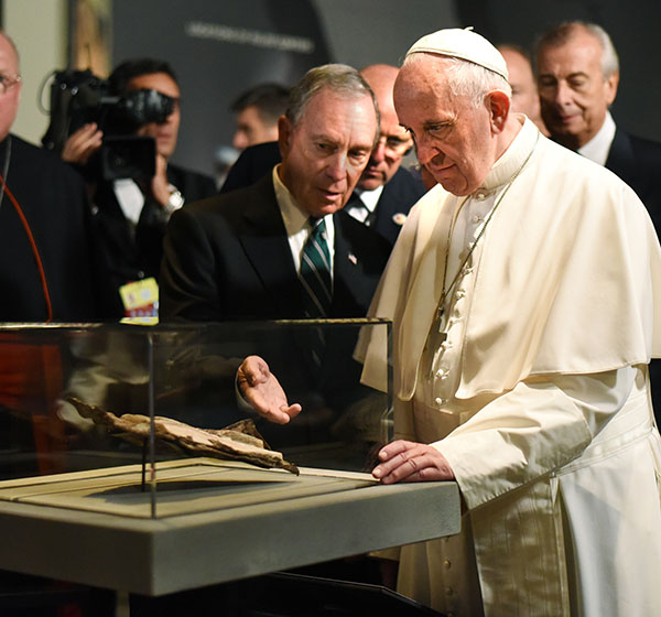 "<div class=""meta image-caption""><div class=""origin-logo origin-image ap""><span>AP</span></div><span class=""caption-text"">Former New York City Mayor Michael Bloomberg  is joined by Pope Francis as he views a New Testament bible fragment found in debris of the South Tower of the World Trade Center. (Carmine Galasso/The Record of Bergen County via AP, Pool)</span></div>"
