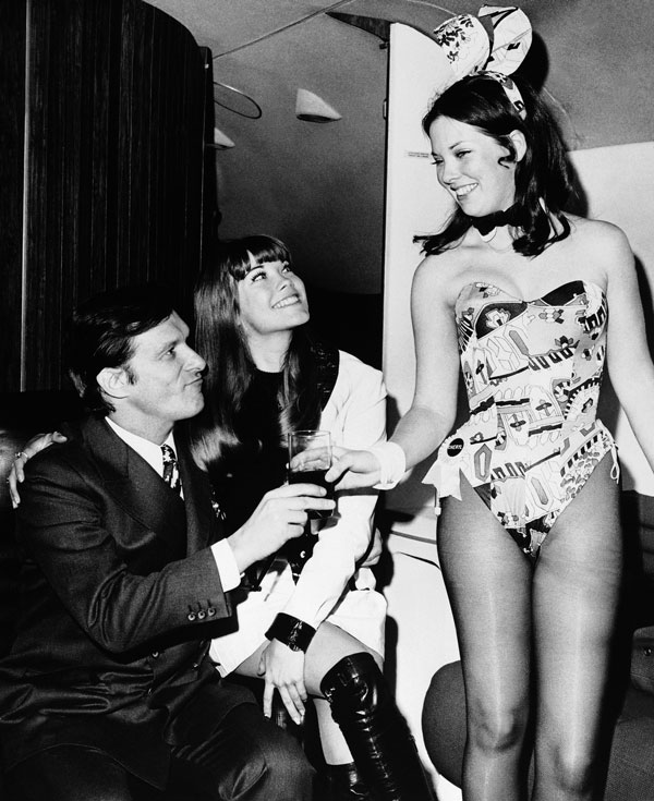 <div class='meta'><div class='origin-logo' data-origin='AP'></div><span class='caption-text' data-credit=''>In March 1970, Hugh Hefner and girlfriend Barbi Benton, center, are served by a Playboy Club bunny upon their arrival aboard the Big Bunny, Heffner's jet, in New York.</span></div>