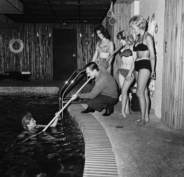 <div class='meta'><div class='origin-logo' data-origin='AP'></div><span class='caption-text' data-credit=''>Playing at having fun, Hugh Hefner rescues one of the swimmers in the indoor pool of his $400,000 apartment, June 20, 1961, Chicago.</span></div>