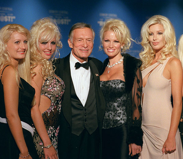 "<div class=""meta image-caption""><div class=""origin-logo origin-image ap""><span>AP</span></div><span class=""caption-text"">Hugh Hefner appears with Pamela Anderson and some of his girlfriends before the New York Friars Club Roast on Sept. 29, 2001.</span></div>"