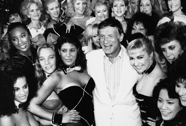 "<div class=""meta image-caption""><div class=""origin-logo origin-image ap""><span>AP</span></div><span class=""caption-text"">Hugh Hefner poses with current and former Playboy bunnies at the Playboy Club, June 25, 1986, in Los Angeles.</span></div>"