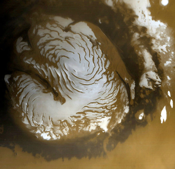 <div class='meta'><div class='origin-logo' data-origin='none'></div><span class='caption-text' data-credit='Photo/AP'>This March 13, 1999, image is a wide-angle view of the Martian north polar cap as it appeared to the Mars Orbiter Camera.</span></div>