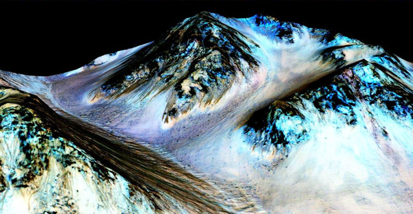 <div class='meta'><div class='origin-logo' data-origin='none'></div><span class='caption-text' data-credit='NASA/JPL/University of Arizona'>Scientists believe these 100 meter-long streaks called recurring slope lineae, shown here on a  false color image, are strong evidence of flowing water on Mars.</span></div>