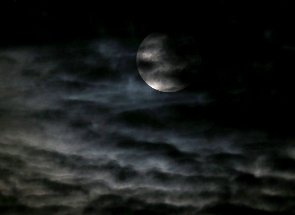 <div class='meta'><div class='origin-logo' data-origin='none'></div><span class='caption-text' data-credit='Photo/AP'>The supermoon is seen through the clouds over Chicago overnight on Sept. 27, the night of a lunar eclipse.</span></div>
