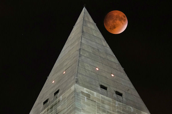 <div class='meta'><div class='origin-logo' data-origin='none'></div><span class='caption-text' data-credit='Photo/AP'>The supermoon is seen over Washington, D.C., overnight on Sept. 27, the night of a lunar eclipse.</span></div>