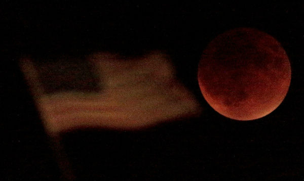 <div class='meta'><div class='origin-logo' data-origin='none'></div><span class='caption-text' data-credit='Photo/AP'>The supermoon is seen over Kansas City, Mo., overnight on Sept. 27, the night of a lunar eclipse.</span></div>