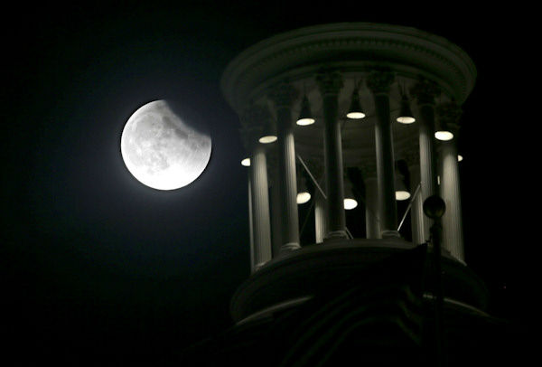 <div class='meta'><div class='origin-logo' data-origin='none'></div><span class='caption-text' data-credit='Photo/AP'>The supermoon is seen over  Sacramento, Calif., overnight on Sept. 27, the night of a lunar eclipse.</span></div>
