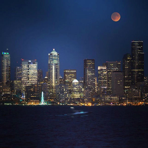 <div class='meta'><div class='origin-logo' data-origin='none'></div><span class='caption-text' data-credit='Instagram/fangshangwei'>The supermoon is seen over Seattle overnight on Sept. 27, the night of a lunar eclipse.</span></div>