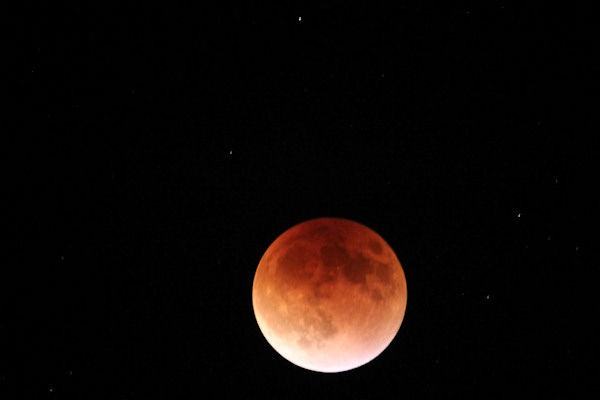 <div class='meta'><div class='origin-logo' data-origin='none'></div><span class='caption-text' data-credit='Kara Conway/KTRK'>The supermoon is seen over Tuscon, Ariz. overnight on Sept. 27, the night of a lunar eclipse.</span></div>