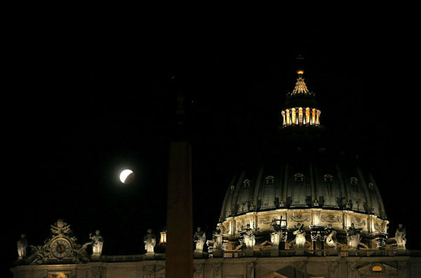 <div class='meta'><div class='origin-logo' data-origin='none'></div><span class='caption-text' data-credit='Photo/AP'>The supermoon is seen over the Vatican in Vatican City overnight on Sept. 27, the night of a lunar eclipse.</span></div>