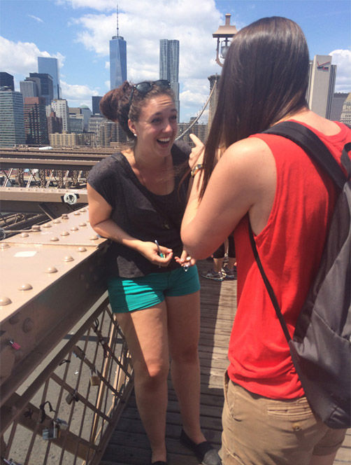 """<div class=""""meta image-caption""""><div class=""""origin-logo origin-image """"><span></span></div><span class=""""caption-text"""">As the couple were attaching locks to the bridge, Harris proposed to a shocked Fader, with her ring attached to one of the locks. (Erin Raine)</span></div>"""