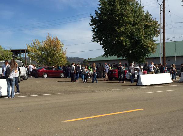 <div class='meta'><div class='origin-logo' data-origin='none'></div><span class='caption-text' data-credit='@sehurwitz/KEZI'>Photo of students are getting picked up at the Douglas County Fairgrounds.</span></div>
