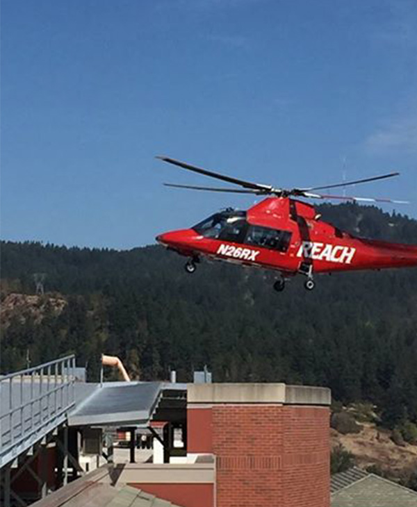 <div class='meta'><div class='origin-logo' data-origin='none'></div><span class='caption-text' data-credit='Sacred Heart Medical Center/Facebook'>Two victims arriving (REACH helicopter landing pictured here) at PeaceHealth Sacred Heart Medical Center in Oregon.</span></div>