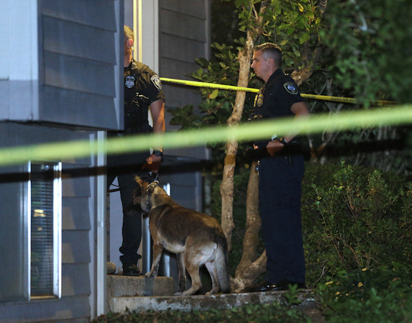 <div class='meta'><div class='origin-logo' data-origin='none'></div><span class='caption-text' data-credit='AP Photo/Rich Pedroncelli'>Law enforcement officers investigate a home in Roseburg, Ore., on Thursday.  A gunman opened fire inside a classroom at Umpqua Community College.</span></div>