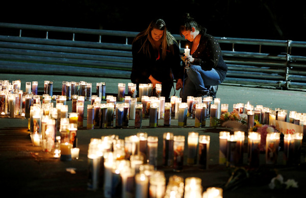 <div class='meta'><div class='origin-logo' data-origin='none'></div><span class='caption-text' data-credit='AP Photo/John Locher'>Meriah Calvert, left, of Roseburg, Ore., and an unidentified woman pray after a candlelight vigil for victims of a shooting at Umpqua Community College on Thursday.</span></div>