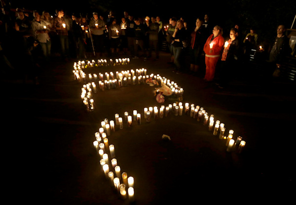 <div class='meta'><div class='origin-logo' data-origin='none'></div><span class='caption-text' data-credit='AP Photo/Rich Pedroncelli'>Candles spelling UCC for Umpqua Community College, are displayed at a candlelight vigil for those killed during a fatal shooting at the school Thursday.</span></div>