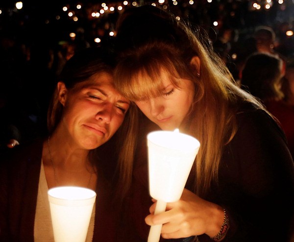<div class='meta'><div class='origin-logo' data-origin='none'></div><span class='caption-text' data-credit='AP Photo/Rich Pedroncelli'>Kristen Sterner, left, and Carrissa Welding, both students at Umpqua Community College, embrace each other during a candlelight vigil for those killed during a shooting Thursday.</span></div>