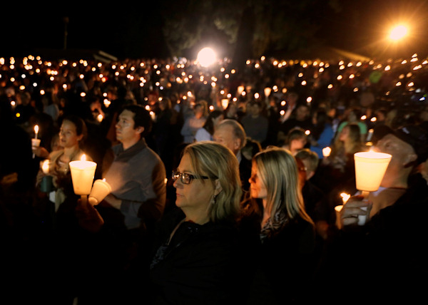 <div class='meta'><div class='origin-logo' data-origin='none'></div><span class='caption-text' data-credit='AP Photo/Rich Pedroncelli'>Community members gather for a candlelight vigil for those killed in a shooting at Umpqua Community College in Roseburg, Ore., Thursday.</span></div>