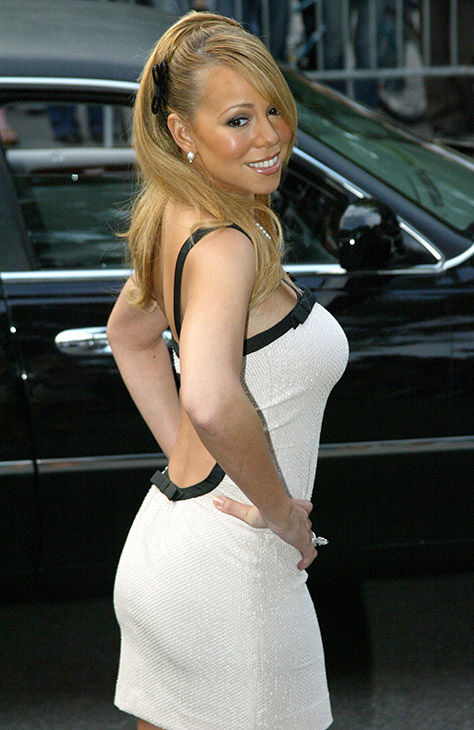 <div class='meta'><div class='origin-logo' data-origin='none'></div><span class='caption-text' data-credit='AP'>Mariah Carey poses for photographers upon arrival, at the Fresh Air Fund Salute To American Heroes, at Tavern On the Green, in New York, Thursday, June 5, 2003.</span></div>