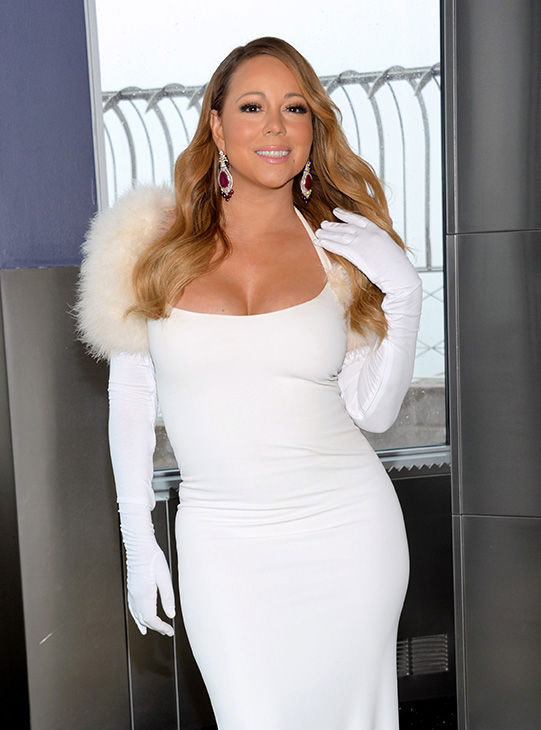 <div class='meta'><div class='origin-logo' data-origin='none'></div><span class='caption-text' data-credit='AP'>Singer Mariah Carey poses on the observation deck level at the Empire State Building in honor of the 20th annual Valentine's Day wedding event &#34;Love Above All.&#34;</span></div>