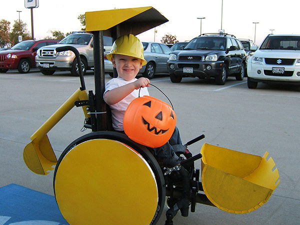 "<div class=""meta image-caption""><div class=""origin-logo origin-image ""><span></span></div><span class=""caption-text"">Halloween 2008 with Caleb, 3, driving his backhoe/scoop truck. (Cassie McLelland)</span></div>"