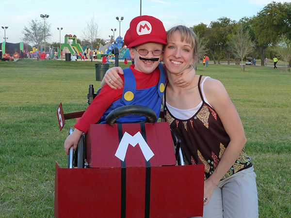 "<div class=""meta image-caption""><div class=""origin-logo origin-image ""><span></span></div><span class=""caption-text""> Caleb with his mother Cassie, who helps make all his costumes. (Glenn McLelland)</span></div>"