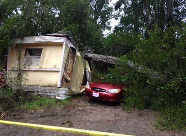 "<div class=""meta image-caption""><div class=""origin-logo origin-image none""><span>none</span></div><span class=""caption-text"">A Florida sheriff's office shared this photo of a tree that had fallen on a mobile home on Friday, saying no injuries had been reported. (Marion County Sheriff/Facebook)</span></div>"