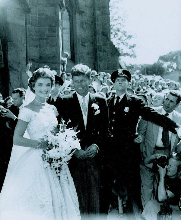"<div class=""meta image-caption""><div class=""origin-logo origin-image ""><span></span></div><span class=""caption-text""> John and Jacqueline Kennedy on their wedding day on September 12, 1953. (RR Auction)</span></div>"