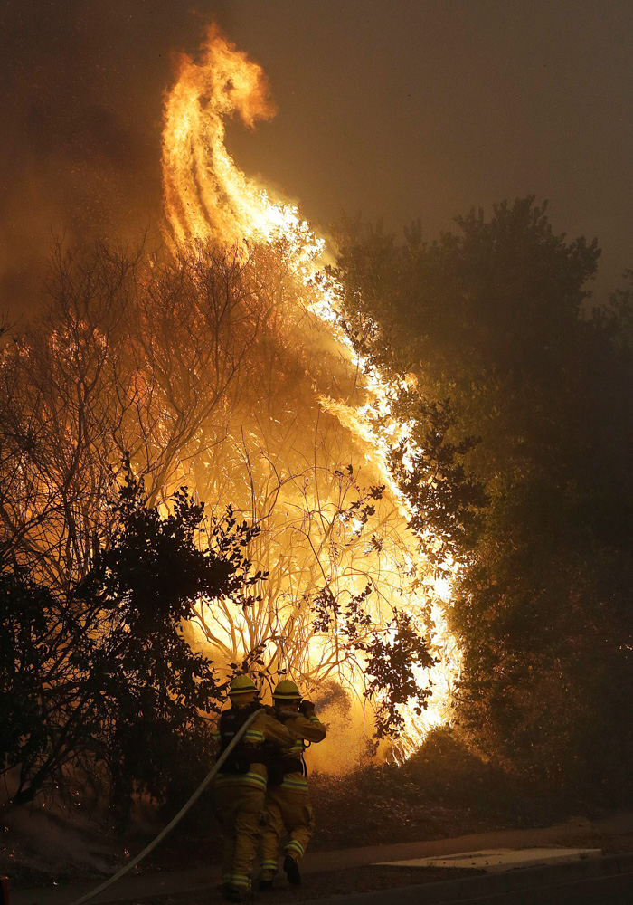 <div class='meta'><div class='origin-logo' data-origin='none'></div><span class='caption-text' data-credit='Jeff Chiu/AP Photo'>Firefighters hose down a burning tree in Santa Rosa, Calif., Monday, Oct. 9, 2017.</span></div>