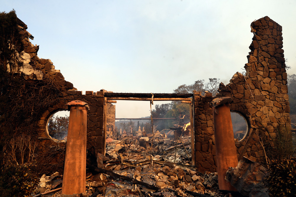<div class='meta'><div class='origin-logo' data-origin='none'></div><span class='caption-text' data-credit='Marcio Jose Sanchez/AP Photo'>The entrance to the fire-ravaged Signorello Estate winery is seen Monday, Oct. 9, 2017, in Napa, Calif.</span></div>