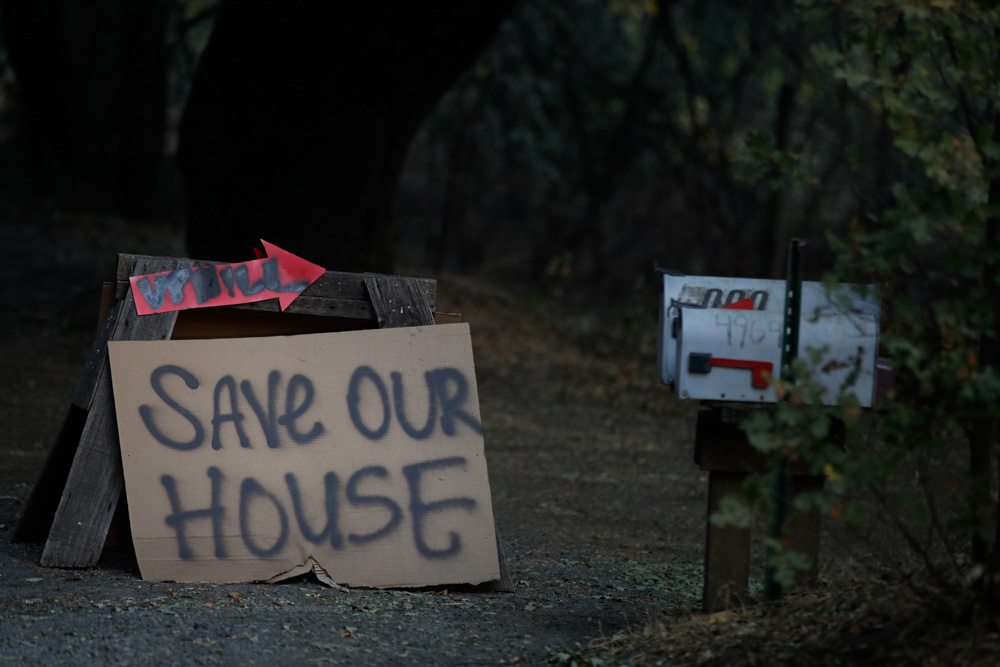 <div class='meta'><div class='origin-logo' data-origin='none'></div><span class='caption-text' data-credit='Jae C. Hong/AP Photo'>A sign stands outside a home as wildfires continue to burn Thursday, Oct. 12, 2017, near Napa, Calif.</span></div>