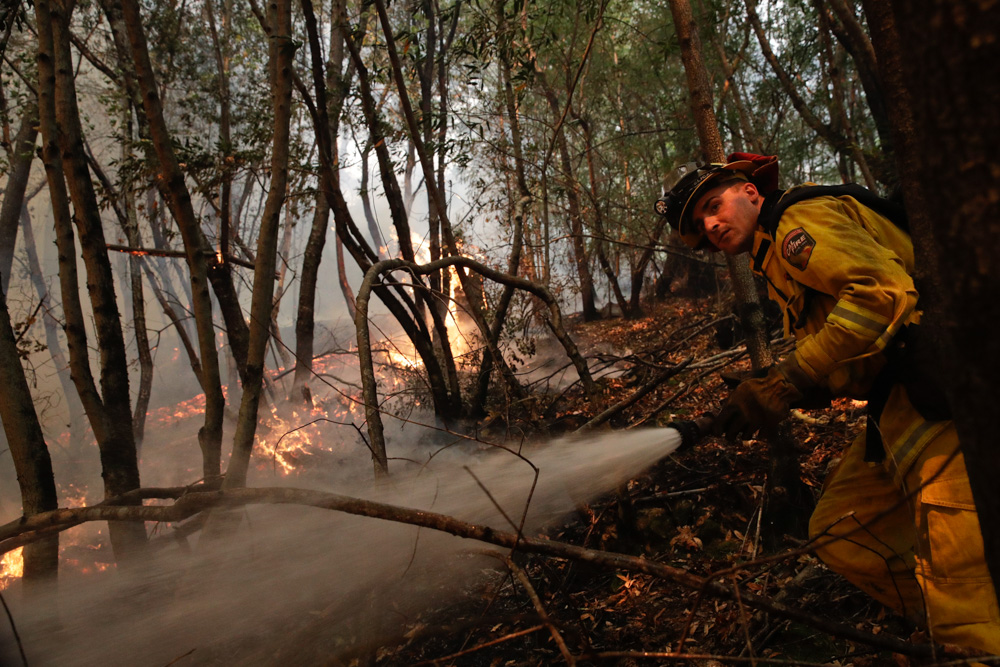 <div class='meta'><div class='origin-logo' data-origin='none'></div><span class='caption-text' data-credit='Jae C. Hong/AP Photo'>A firefighter puts out a hot spot from a wildfire Thursday, Oct. 12, 2017, near Calistoga, Calif.</span></div>