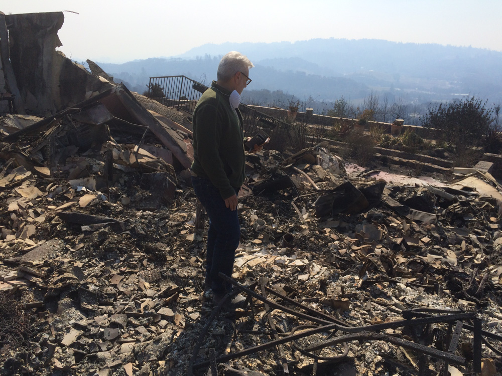 "<div class=""meta image-caption""><div class=""origin-logo origin-image none""><span>none</span></div><span class=""caption-text"">Homeowner Matt Afflixio surveys the remains of his home on Heights Drive in Santa Rosa, Calif. (Dean Smith)</span></div>"