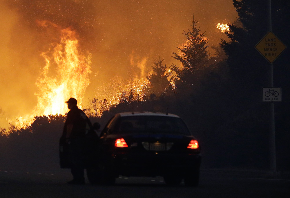 <div class='meta'><div class='origin-logo' data-origin='none'></div><span class='caption-text' data-credit='Jeff Chiu/AP Photo'>A law enforcement officer blocks a road as flames burn in a residential area in Santa Rosa, Calif., Monday, Oct. 9, 2017.</span></div>