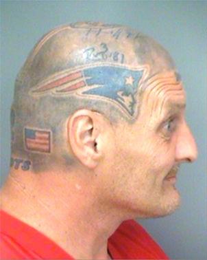Crazy mugshot man with new england patriots memorabilia tattooed onto