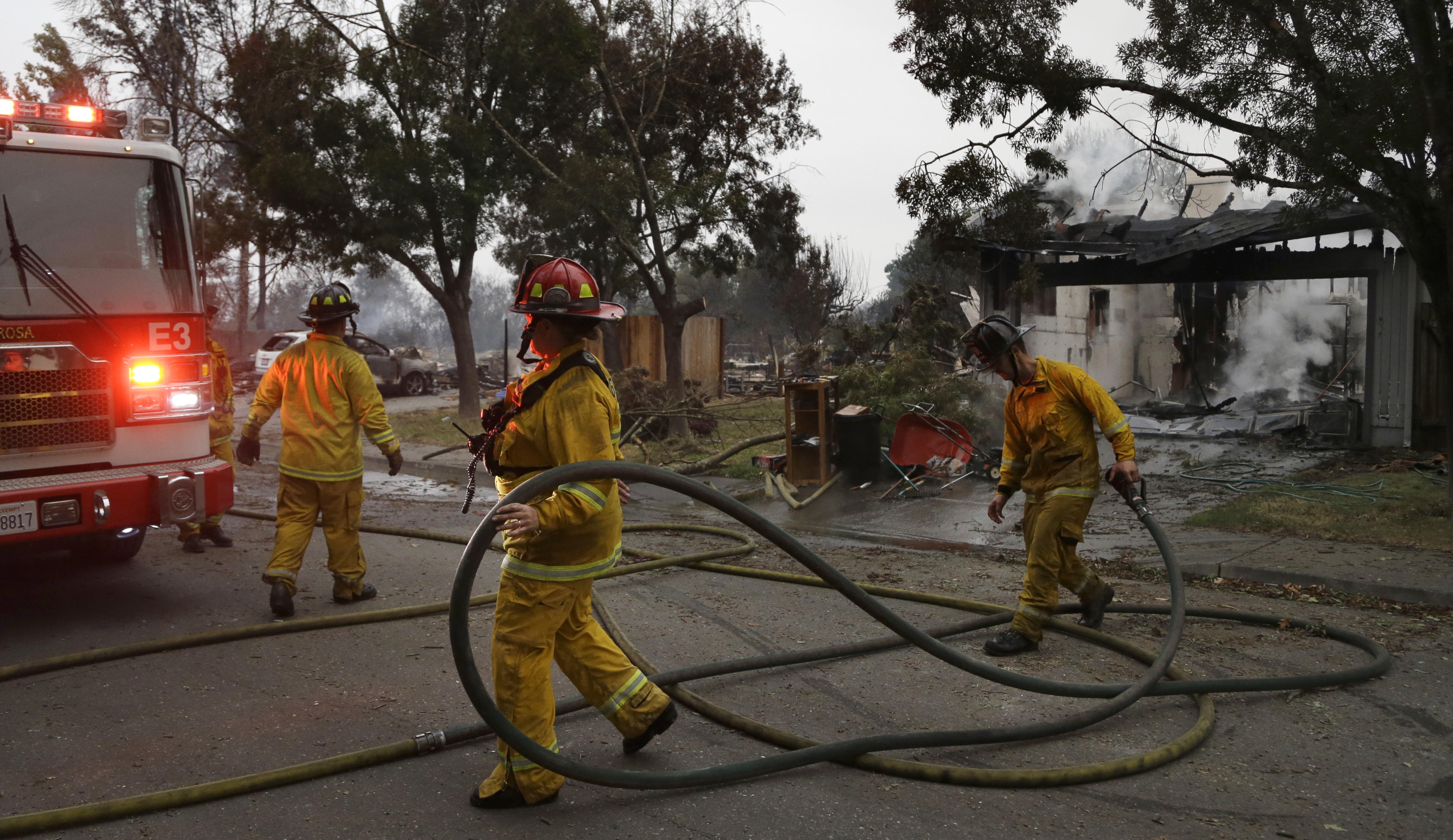 <div class='meta'><div class='origin-logo' data-origin='none'></div><span class='caption-text' data-credit='Ben Margot/AP Photo'>Santa Rosa firefighters carry hose as they battle hotspots in the Coffey Park area of Santa Rosa, Calif., on Tuesday, Oct. 10, 2017.</span></div>