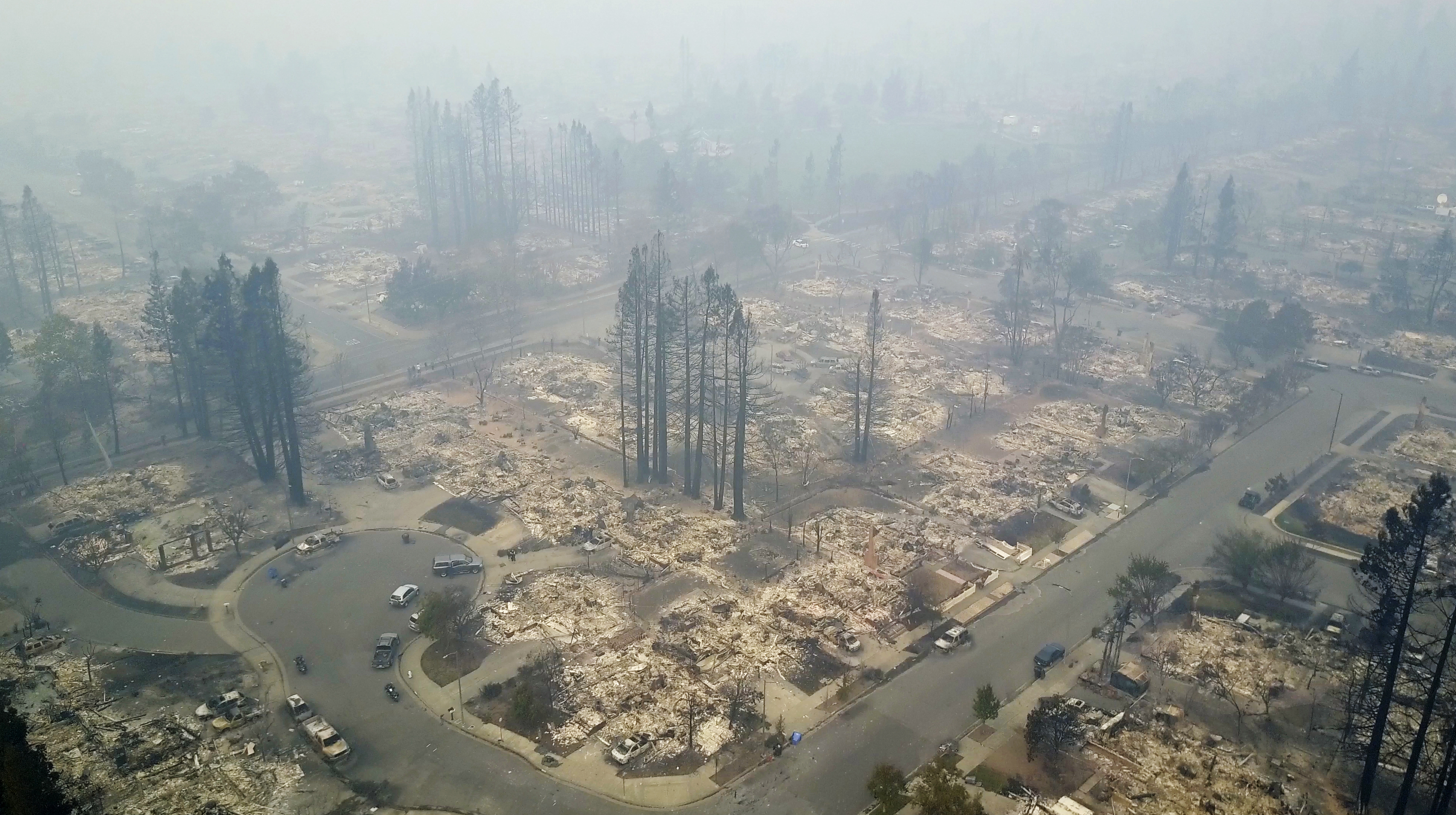 <div class='meta'><div class='origin-logo' data-origin='none'></div><span class='caption-text' data-credit='Nick Giblin/DroneBase via AP'>This aerial image shows a neighborhood that was destroyed by a wildfire in Santa Rosa, Calif., Tuesday, Oct. 10, 2017.</span></div>