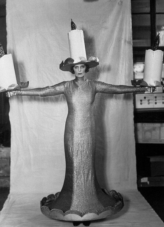 "<div class=""meta image-caption""><div class=""origin-logo origin-image none""><span>none</span></div><span class=""caption-text"">October 10, 1930: The Hon Mrs Roland Cubitt dressed as 'Three Candles' in a costume made by L & H Nathan Ltd, for the ""Pageant Of The Superstitions"" in London. (Sasha/Getty )</span></div>"