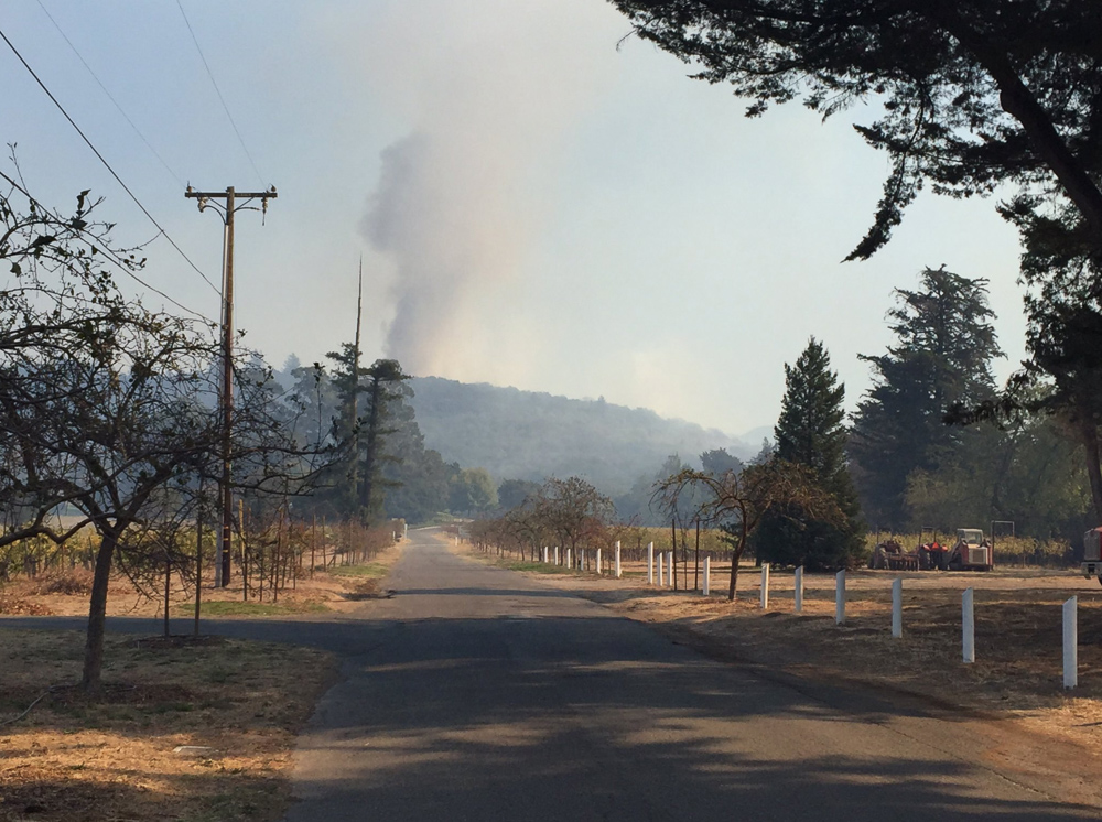 "<div class=""meta image-caption""><div class=""origin-logo origin-image none""><span>none</span></div><span class=""caption-text"">""Active fire northeast and north of #Sonoma shots taken from Bartholomew winery""</span></div>"