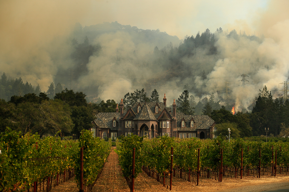 <div class='meta'><div class='origin-logo' data-origin='none'></div><span class='caption-text' data-credit='Jae C. Hong/AP Photo'>A wildfire burns behind a winery Saturday, Oct. 14, 2017, in Santa Rosa, Calif.</span></div>