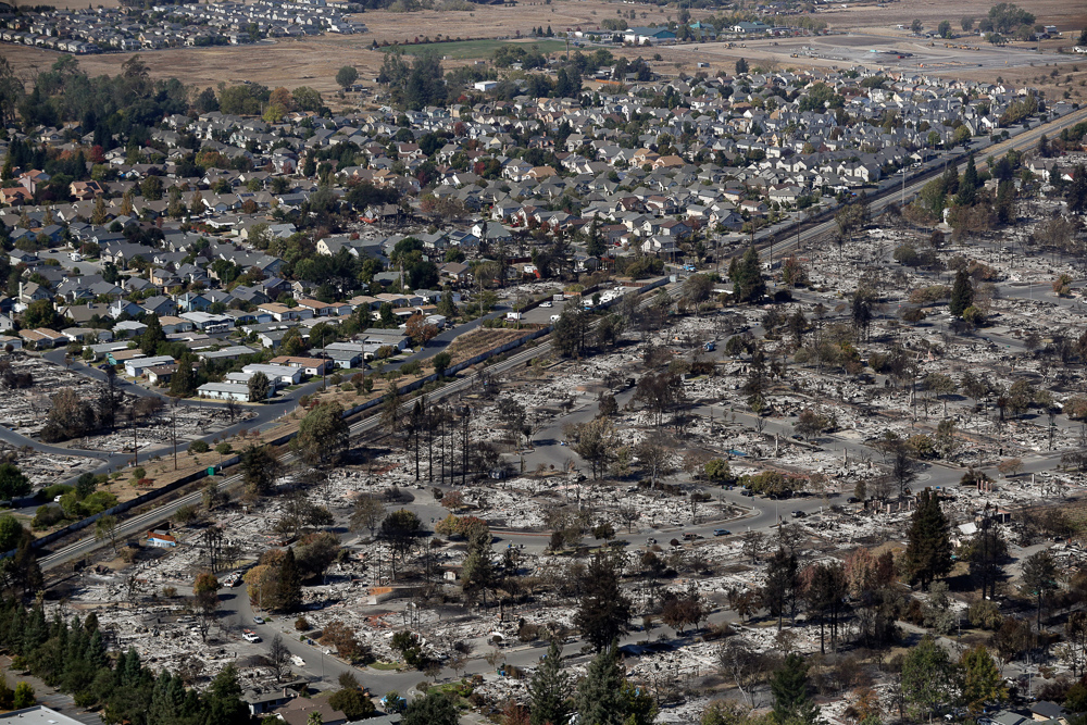 <div class='meta'><div class='origin-logo' data-origin='none'></div><span class='caption-text' data-credit='Marcio Jose Sanchez/AP Photo'>An aerial view shows the devastation of the Coffey Park neighborhood after a wildfire swept through Saturday, Oct. 14, 2017, in Santa Rosa, Calif.</span></div>