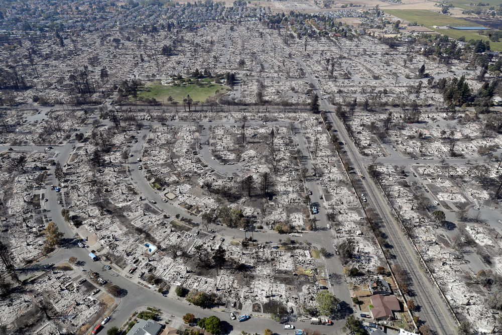"<div class=""meta image-caption""><div class=""origin-logo origin-image none""><span>none</span></div><span class=""caption-text"">An aerial view shows the devastation of the Coffey Park neighborhood after a wildfire swept through Saturday, Oct. 14, 2017, in Santa Rosa, Calif. (Marcio Jose Sanchez/AP Photo)</span></div>"