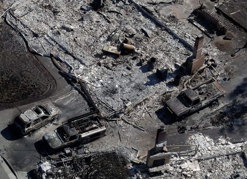 <div class='meta'><div class='origin-logo' data-origin='none'></div><span class='caption-text' data-credit='Marcio Jose Sanchez/AP Photo'>Charred vehicles are seen next to a wildfire-ravaged home in an aerial view Saturday, Oct. 14, 2017, in Santa Rosa, Calif.</span></div>