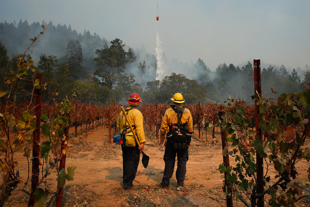 "<div class=""meta image-caption""><div class=""origin-logo origin-image none""><span>none</span></div><span class=""caption-text"">Firefighters Mike Beeman, left, and Chris Oliver watch as a helicopter drops water over a wildfire burning near a winery Saturday, Oct. 14, 2017, in Santa Rosa, Calif. (Jae C. Hong/AP Photo)</span></div>"